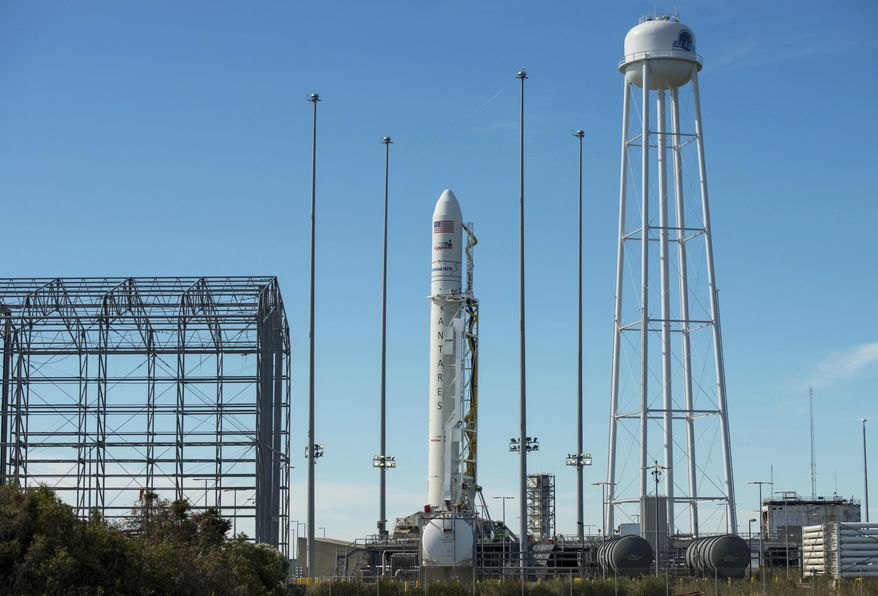 In this Friday, Oct. 14, 2016 photo, an Orbital ATK Antares rocket carrying the Cygnus spacecraft is raised into the vertical position on launch Pad-0A at NASA's Wallops Flight Facility in Virginia. The Sunday, Oct. 16, 2016 scheduled cargo resupply mission to the International Space Station would be the company's first Antares launch since an explosion seconds after liftoff in 2014, which destroyed the rocket and space station supply ship, and damaged the launch complex. (Bill Ingalls/NASA via AP)