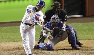 Chicago Cubs' Miguel Montero (47) hits a grand slam during the eighth inning of Game 1 of the National League baseball championship series against the Los Angeles Dodgers Saturday, Oct. 15, 2016, in Chicago. (AP Photo/Charles Rex Arbogast)