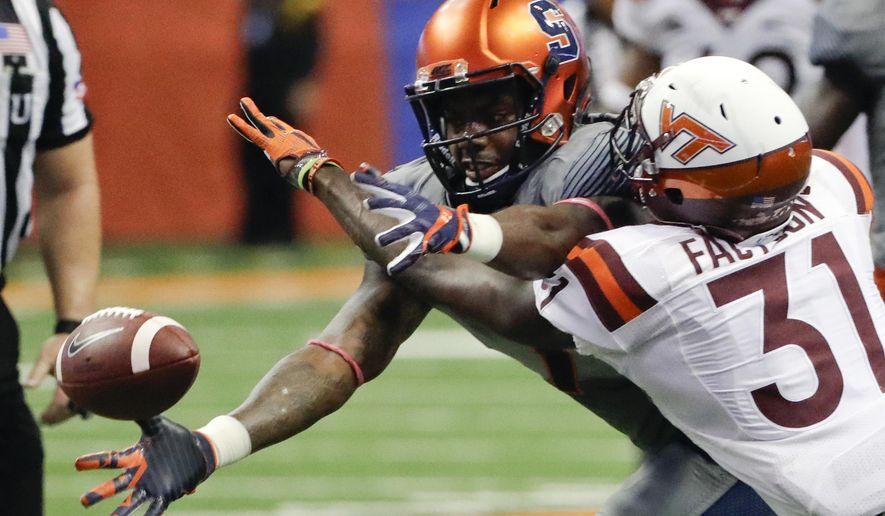 Virginia Tech cornerback Brandon Facyson (31) breaks up a pass intended for Syracuse wide receiver Amba Etta-Tawo during the second half of an NCAA college football game on Saturday, Oct. 15, 2016, in Syracuse, N.Y. (AP Photo/Mike Groll)