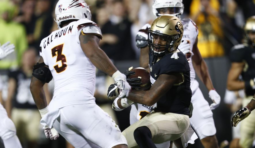 Colorado wide receiver Bryce Bobo, front right, is pulled down after catching a pass for a long gain by Arizona State defensive back Armand Perry, behind Bobo, as Arizona State linebackers DJ Calhoun, front left, and Marcus Ball, back, look on in the first half of an NCAA college football game Saturday, Oct. 15, 2016, in Boulder, Colo. (AP Photo/David Zalubowski)