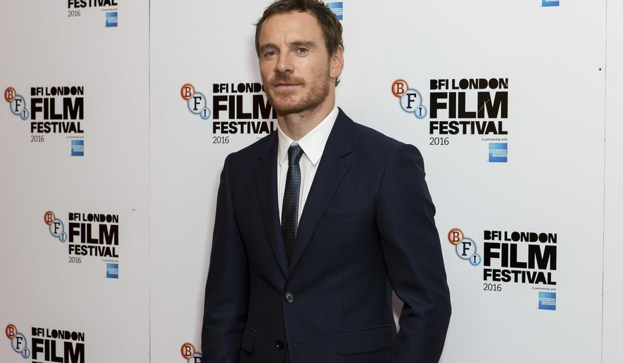 Actor Michael Fassbender poses for photographers upon arrival at the premiere of the film 'Trespass Against Us', showing as part of the London Film Festival in London, Friday, Oct. 14, 2016. (Photo by Grant Pollard/Invision/AP)