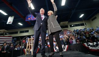 FILE This Monday Feb. 29, 2016 file photo shows Virginia Gov. Terry McAuliffe, left, waves to the crowd along with Democratic presidential candidate Hillary Clinton as she arrives to speak at a campaign rally in Norfolk, Va. Virginia was supposed to be a key battleground state and the high energy governor was expected to spend the weeks leading up to Election Day bouncing around the Old Dominion to help longtime pal Hillary Clinton win the state's 13 electoral votes. (AP Photo/Gerald Herbert)