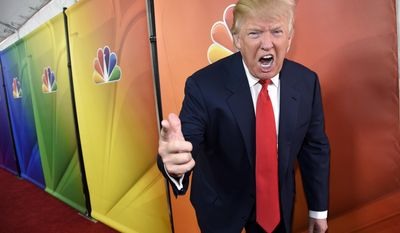 """In this Jan. 16, 2015 file photo, Donald Trump, host of the television series """"The Celebrity Apprentice,"""" mugs for photographers at the NBC 2015 Winter TCA Press Tour in Pasadena, Calif. (Photo by Chris Pizzello/Invision via AP, File)"""