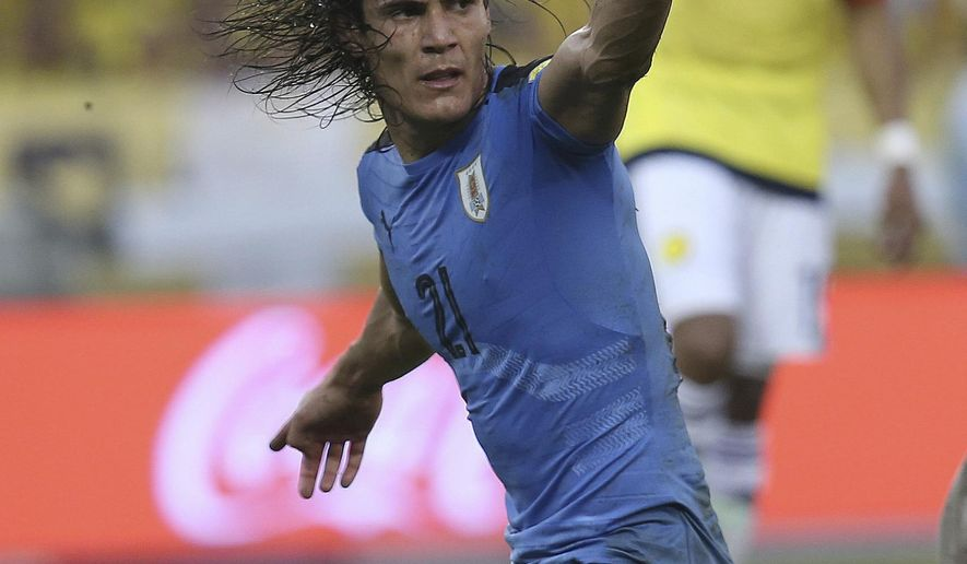 Uruguay's Edinson Cavani reacts after missing a chance to score during a 2018 World Cup qualifying soccer match against Colombia in Barranquilla, Colombia, Tuesday, Oct. 11, 2016. (AP Photo/Fernando Vergara)