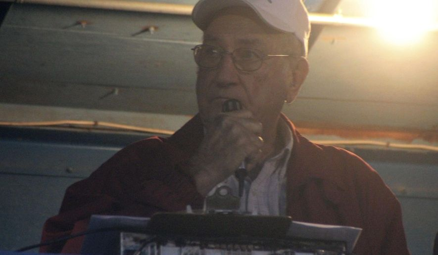 In this Aug. 26, 2016 photo, Vernell Korth announced a football game for Lindsay, in Lindsay, Neb. For 44 years, it's been  Korth who has been describing the action on the field. The Norfolk Daily News reports Korth started announcing in 1972 in the middle of the season because the school needed an announcer.  (Patrick Murphy /The Norfolk Daily News via AP)