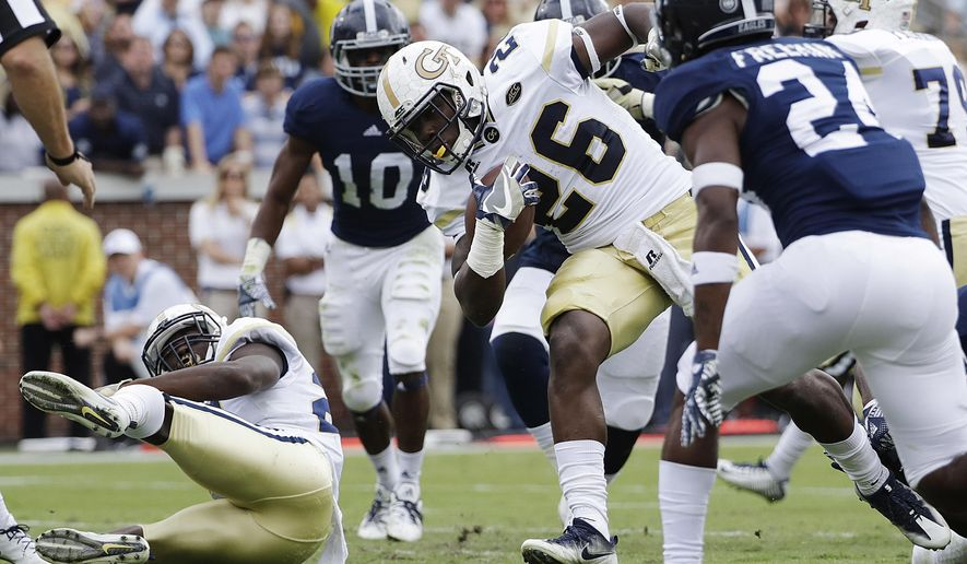 Georgia Tech's Dedrick Mills (26) runs the ball for a touchdown in the first quarter of an NCAA college football game against Georgia Southern in Atlanta, Saturday, Oct. 15, 2016. (AP Photo/David Goldman)