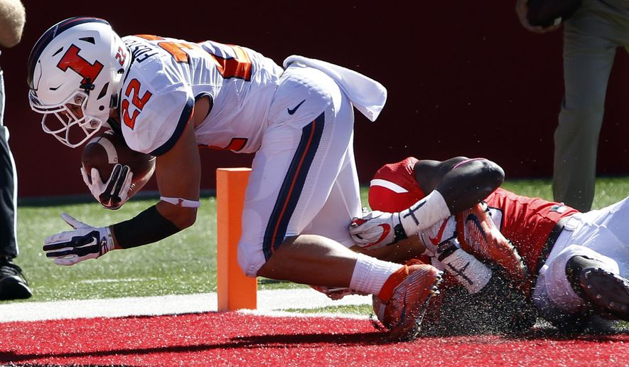 Illinois running back Kendrick Foster (22) scores a touchdown during the first half of a NCAA college football game against Rutgers Saturday, Oct. 15, 2016, in Piscataway, N.J. (AP Photo/Mel Evans)