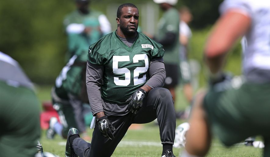 FILE - In this Wednesday, June 1, 2016, file photo, New York Jets linebacker David Harris (52) stretches during NFL football practice in Florham Park, N.J. Harris was listed Saturday, Oct. 15, as doubtful to play against the Arizona Cardinals on Monday night because of a hamstring injury, putting his streak of 121 consecutive games played in jeopardy. (AP Photo/Mel Evans, File)