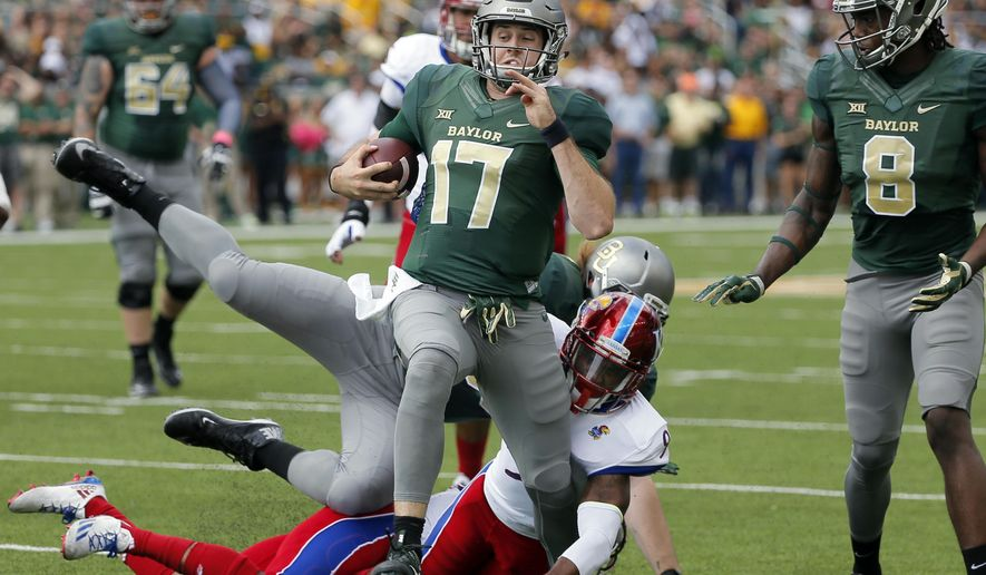 Baylor quarterback Seth Russell (17) escapes a tackle attempt by Kansas safety Fish Smithson (9) as wide receiver Ishmael Zamora (8) watches Russell continue on to the end zone for a touchdown in the first half of an NCAA college football game, Saturday, Oct. 15, 2016, in Waco, Texas. (AP Photo/Tony Gutierrez)