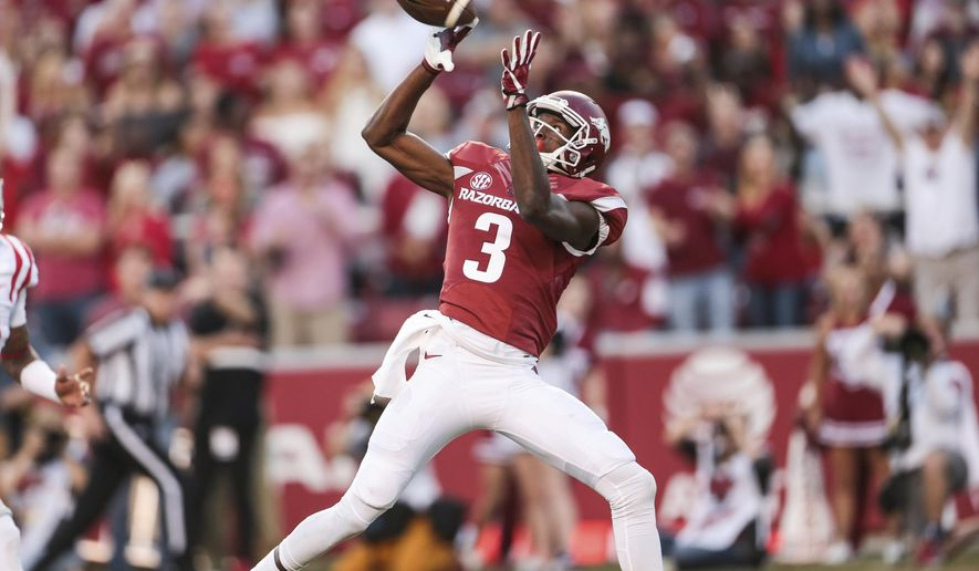 Arkansas wide receiver Dominique Reed (3) catches a touchdown during the second quarter of an NCAA football game against Mississippi on Saturday, Oct. 15, 2016, in Fayetteville, Ark. (AP Photo/Chris Brashers)
