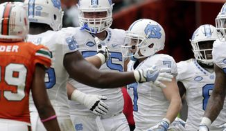 North Carolina wide receiver Austin Proehl (7) is congratulated after scoring a touchdown during the first half of an NCAA college football game against Miami, Saturday, Oct. 15, 2016, in Miami Gardens, Fla. (AP Photo/Lynne Sladky)