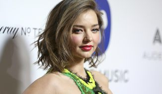FILE - In this Feb. 15, 2016 file photo, Miranda Kerr arrives at the Warner Music Group Grammy Awards After Party at Milk Studios in Los Angeles.  Media reports say an intruder outside the mansion of  Kerr has been shot by a security guard, and Kerr wasn't home at the time. A Los Angeles Sheriff's Department spokesman said that an intruder at a Malibu residence Friday, Oct. 14, was shot three times after he stabbed a security guard late-morning Friday.  Sgt. Jeff Delrio said Saturday he could not immediately provide the home address or confirm that the property was Kerr's residence.(Photo by Rich Fury/Invision/AP)