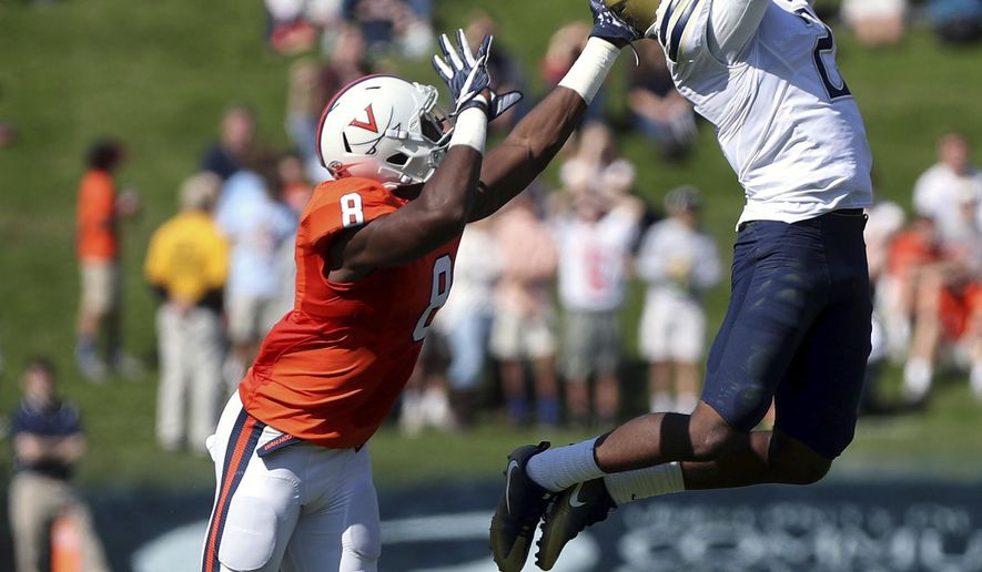 Pittsburgh defensive back Terrish Webb (2) disrupts a pass intended for Virginia wide receiver Keeon Johnson (8) during the first half of an NCAA college football game on Saturday, Oct. 15, 2016 in Charlottesville, Va. (Ryan M. Kelly/The Daily Progress via AP)
