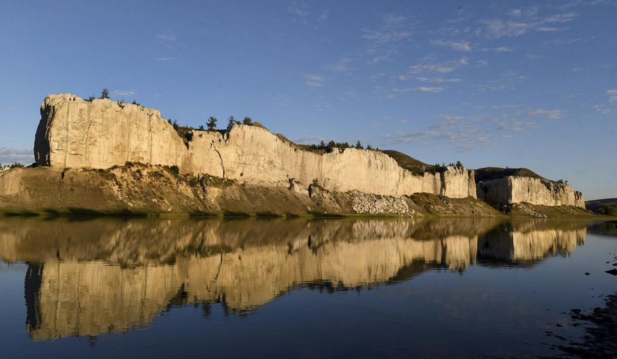 This Sept. 28, 2016 photo shows the White Cliffs reflect off the Missouri river in Montana. It's been 40 years since Montana has added any Wild and Scenic Rivers, a point river advocates are trying to change and get the East Rosebud Creek added by year's end. (Kurt Wilson /The Missoulian via AP)