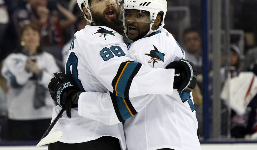 San Jose Sharks forward Joel Ward, right, celebrates his goal against the Columbus Blue Jackets with teammate defenseman Brent Burns during the first period of an NHL preseason hockey game in Columbus, Ohio, Saturday, Oct. 15, 2016. (AP Photo/Paul Vernon)