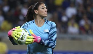 "FILE - In this Aug. 3, 2016, file photo, United States' goalkeeper Hope Solo takes the ball during a women's soccer game at the Rio Olympics against New Zealand in Belo Horizonte, Brazil. Hope Solo says she's received several offers to play overseas and could even continue her career in Sweden, whose fans she enraged by describing their national team as ""cowards"" at the Rio Olympics. (AP Photo/Eugenio Savio, File)"