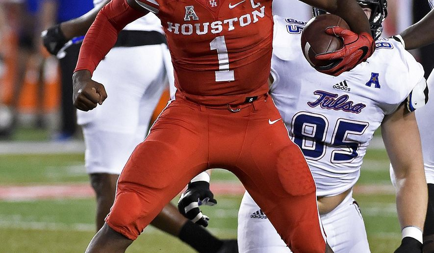 Houston quarterback Greg Ward Jr. (1) celebrates a first down in the first half of an NCAA college football game against Tulsa, Saturday, Oct. 15, 2016, in Houston. (AP Photo/Eric Christian Smith)
