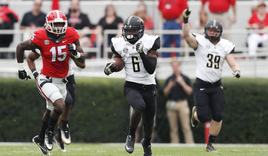 Vanderbilt's Darrius Sims (6) tries to out run Georgia's D'Andre Walker (15) as he returns the opening kickoff in the first half of an NCAA college football game Saturday, Oct. 15, 2016, in Athens, Ga. Walker's return setup a touchdown. (AP Photo/John Bazemore)