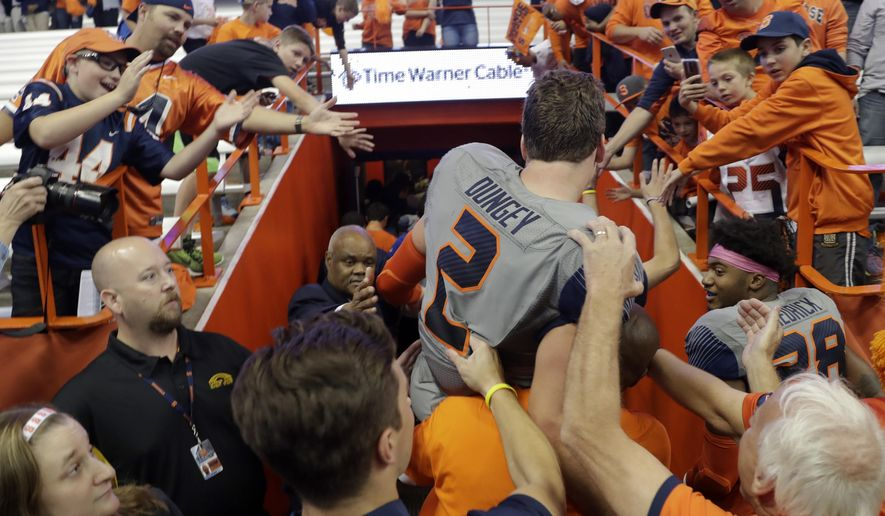 Syracuse quarterback Eric Dungey (2) is carried off the field after his team's 31-17 win over Virginia Tech in an NCAA college football game on Saturday, Oct. 15, 2016, in Syracuse, N.Y. (AP Photo/Mike Groll)