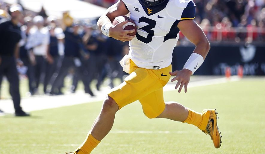 West Virginia's Skyler Howard (3) runs the ball down field to score a touchdown against Texas Tech during an NCAA college football game, Saturday, Oct. 15, 2016, in Lubbock, Texas. (Brad Tollefson/Lubbock Avalanche-Journal via AP)