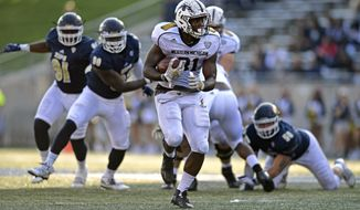Western Michigan running back Jarvion Franklin carries the ball in the second quarter of an NCAA college football game against Akron, Saturday, Oct. 15, 2016, in Akron, Ohio. (AP Photo/David Dermer)