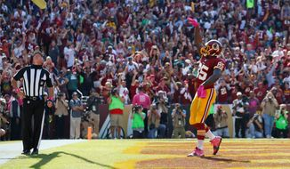 Redskins tight end Vernon Davis was assessed a 15-yard excessive celebration penalty after mimicking a basketball jump shot after his touchdown on Sunday. (Associated Press)