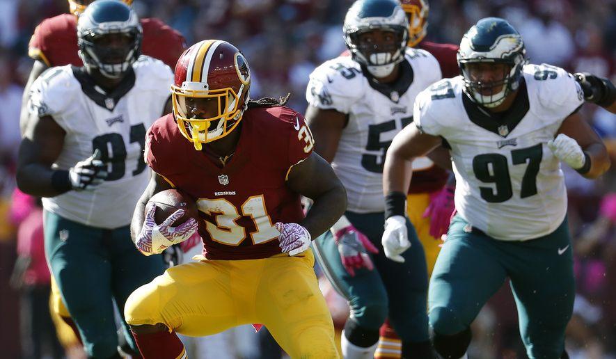 Washington Redskins running back Matt Jones (31) rushes the ball in the second half of an NFL football game against the Philadelphia Eagles, Sunday, Oct. 16, 2016, in Landover, Md. (AP Photo/Alex Brandon)