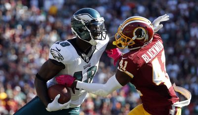 Philadelphia Eagles wide receiver Dorial Green-Beckham, left, tries to avoid Washington Redskins free safety Will Blackmon as he rushes the ball in the second half of an NFL football game, Sunday, Oct. 16, 2016, in Landover, Md. (AP Photo/Alex Brandon)