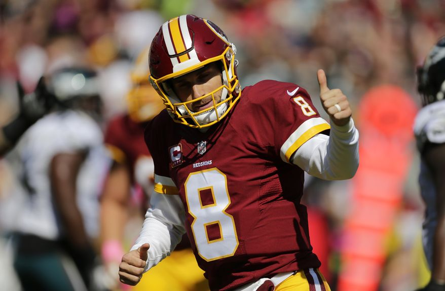 Washington Redskins quarterback Kirk Cousins gestures after throwing a touchdown pass to wide receiver Jamison Crowder in the first half of an NFL football game against the Philadelphia Eagles, Sunday, Oct. 16, 2016, in Landover, Md. (AP Photo/Mark Tenally)