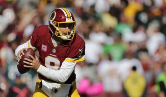 Washington Redskins quarterback Kirk Cousins looks for a receiver in the second half of an NFL football game against the Philadelphia Eagles, Sunday, Oct. 16, 2016, in Landover, Md. (AP Photo/Mark Tenally)