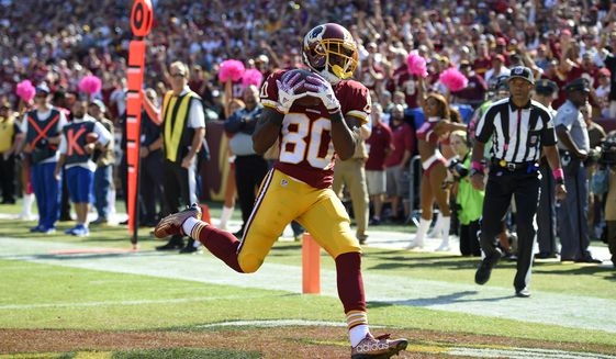 Washington Redskins wide receiver Jamison Crowder scores a touchdown in the first half of an NFL football game against the Philadelphia Eagles, Sunday, Oct. 16, 2016, in Landover, Md. (AP Photo/Nick Wass)