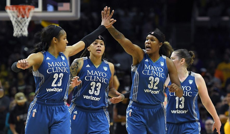 Members of the Minnesota Lynx, from left, Maya Moore, Seimone Augustus, Rebekkah Brunson and Lindsay Whalen celebrate during the second half in Game 4 of the WNBA Finals against the Los Angeles Sparks, Sunday, Oct. 16, 2016, in Los Angeles. The Lynx won 85-79. (AP Photo/Mark J. Terrill)