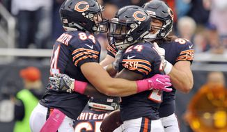 CORRECTS TO SUNDAY NOT FRIDAY - Chicago Bears running back Jordan Howard (24) celebrates with tight end Ben Braunecker (84) after he ran for a touchdown against the Jacksonville Jaguars during the first half of an NFL football game in Chicago, Sunday, Oct. 16, 2015. (AP Photo/Paul Beaty)