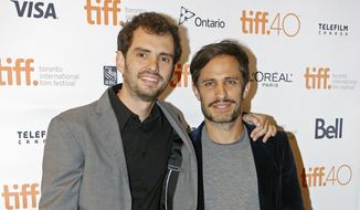 """FILE - In this Sept. 13, 2015 file photo, filmmaker Jonas Cuaron, left, and actor Gael Garcia Bernal attend the premiere for """"Desierto"""" at the Toronto International Film Festival in Toronto. The film opened in the U.S. on Friday, Oct. 14, 2016. (Photo by Tony Felgueiras/Invision/AP, File)"""