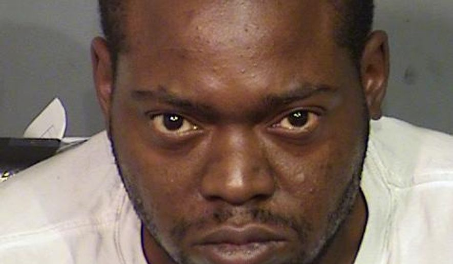 This Saturday, Oct. 15, 2016 photo provided by the Las Vegas Metro Police Department shows Kenneth McDonald, who is facing several charges including murder. Las Vegas police said he was randomly shooting at cars on the freeway when he killed a woman. (Las Vegas Metro Police Department via AP)
