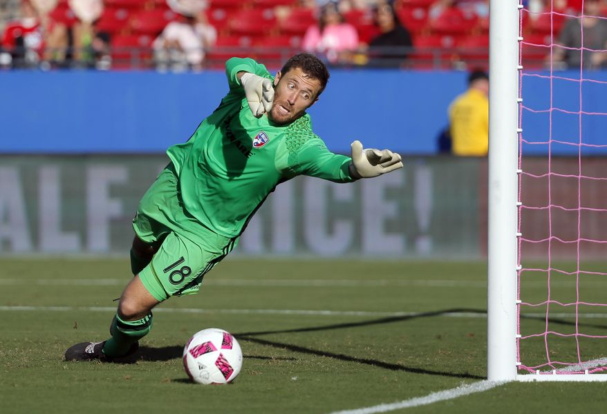 FC Dallas goalkeeper Chris Seitz (18) is unable to stop a shot for a goal by Seattle Sounders midfielder Nicolas Lodeiro in the first half of an MLS soccer match, Sunday, Oct. 16, 2016, in Frisco, Texas. (AP Photo/Tony Gutierrez)
