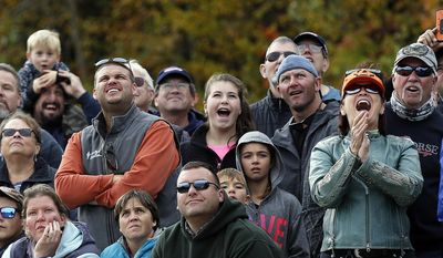 "In this Saturday, Oct. 15, 2016 photo, spectators watch pumpkins get launched jingo the sky during the ""Extreme Chunkin"" contest at New Hampshire Motor Speedway in Loudon, N.H. (AP Photo/Jim Cole)"