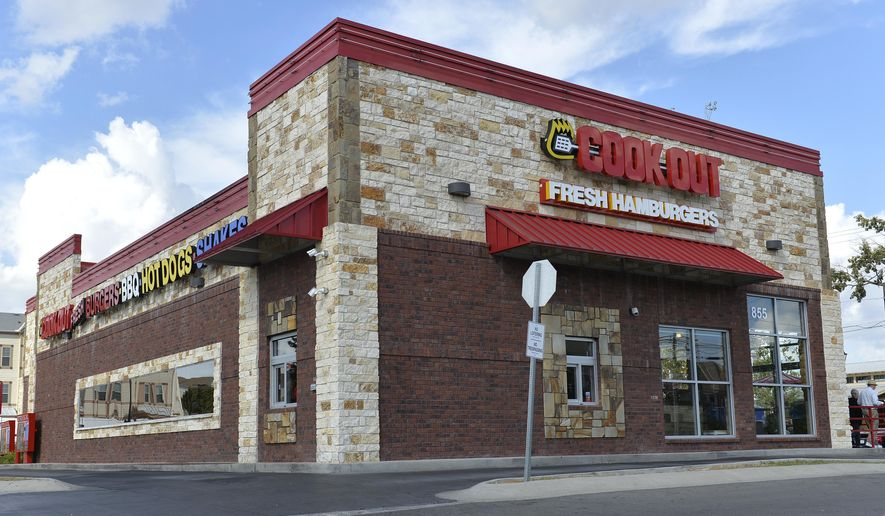 The exterior of a Cook Out restaurant is shown in Lexington, Ky. (AP Photo/Timothy D. Easley)