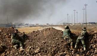 Kurdish security forces take position overlooking the Islamic State-controlled villages surrounding Mosul on Monday, the beginning of what Pentagon officials say could be a drawn-out operation to liberate Iraq's second-largest city from Islamic State control. (Associated Press)