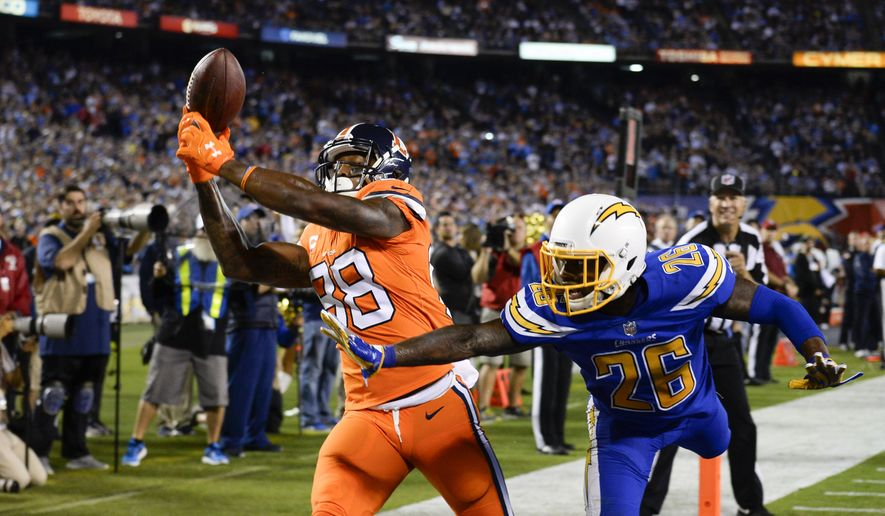 Denver Broncos wide receiver Demaryius Thomas (88) tries to make a catch past the defense of San Diego Chargers cornerback Casey Hayward (26) during the second half of an NFL football game Thursday, Oct. 13, 2016, in San Diego. (AP Photo/Denis Poroy)