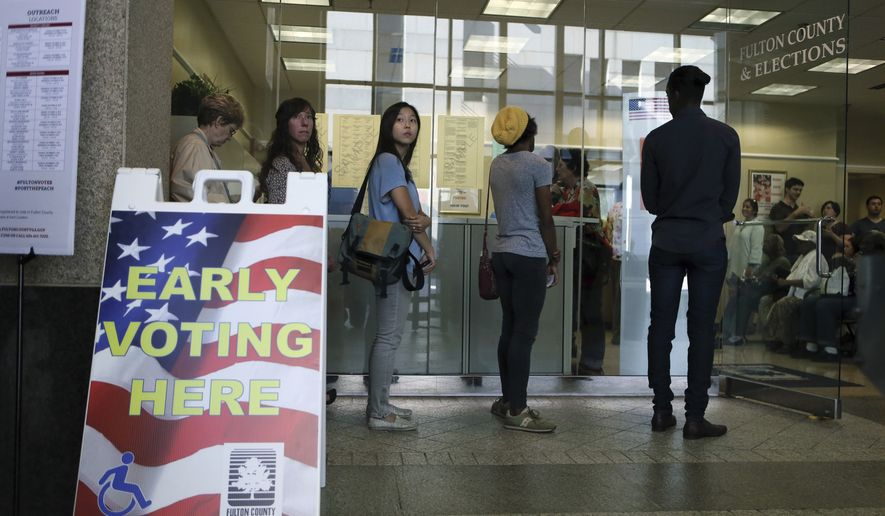 The line for voting extended out of the building at the Fulton County Government Center where the first day of early voting had begun, Monday, Oct. 17, 2016 in Atlanta in this file photo. (Bob Andres/Atlanta Journal-Constitution via AP) **FILE**