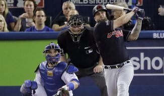 Mike Napoli of the Indians watches his home during the fourth inning in Game 3 of the American League Championship Series against the Toronto Blue Jays on Monday in Toronto. (Associated Press)