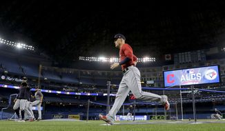 Members of the Cleveland Indians warm up before Game 3 of baseball's American League Championship Series against the Toronto Blue Jays in Toronto, Monday, Oct. 17, 2016. (AP Photo/Charlie Riedel)