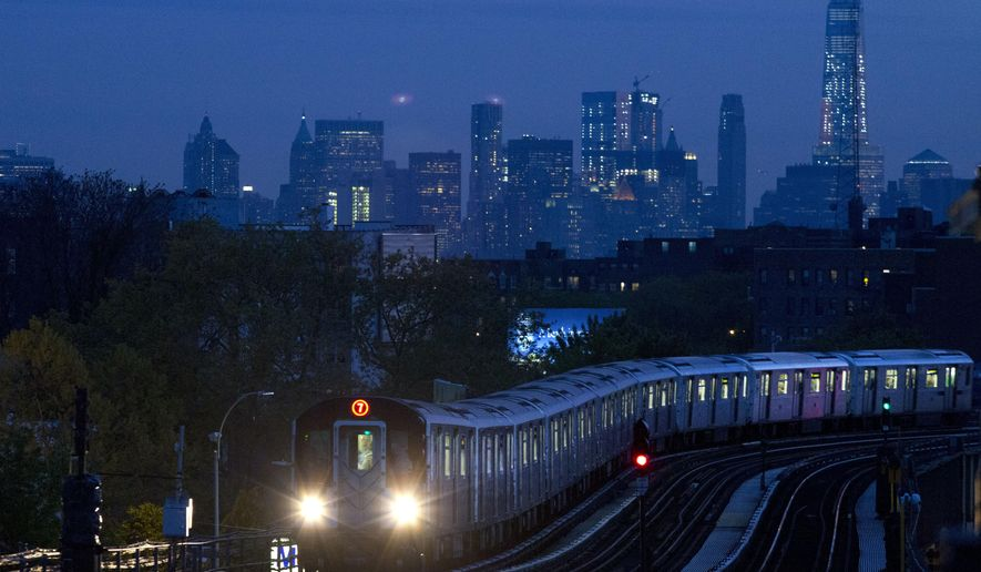 In this May 11, 2016 photo, a No. 7 subway train rides the rails in the Queens borough of New York. In the background is the Manhattan skyline. On Monday, Oct. 17, 2016, the Federal Reserve of New York releases its October survey of manufacturers in the state. (AP Photo/Mark Lennihan)