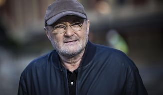 Singer Phil Collins poses for photographers during a photo call to promote his upcoming tour and book 'Not Dead Yet' in London, Monday, Oct. 17, 2016. (Photo by Vianney Le Caer/Invision/AP)