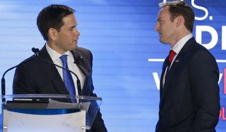 Sen. Marco Rubio, R-Fla., left, and Rep. Patrick Murphy, D-Fla., talk during a commercial break in their debate at the University of Central Florida, Monday, Oct. 17, 2016, in Orlando, Fla. (AP Photo/John Raoux)