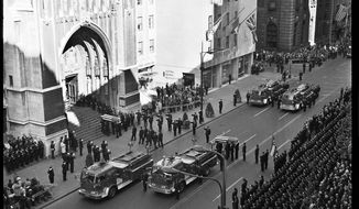 In this Oct. 17, 1966 photo, Fire Department of New York firefighters stand at attention as the caskets of fallen firefighters are brought to a New York church for funeral services after a blaze that began on Oct. 17, 1966 in the basement of a business on Manhattan's East 23rd St. killed 12 firefighters. The blaze fifty years ago remained the deadliest day in FDNY's history, until the department lost 343 members on Sept. 11, 2001. (Fire Department of New York via AP)