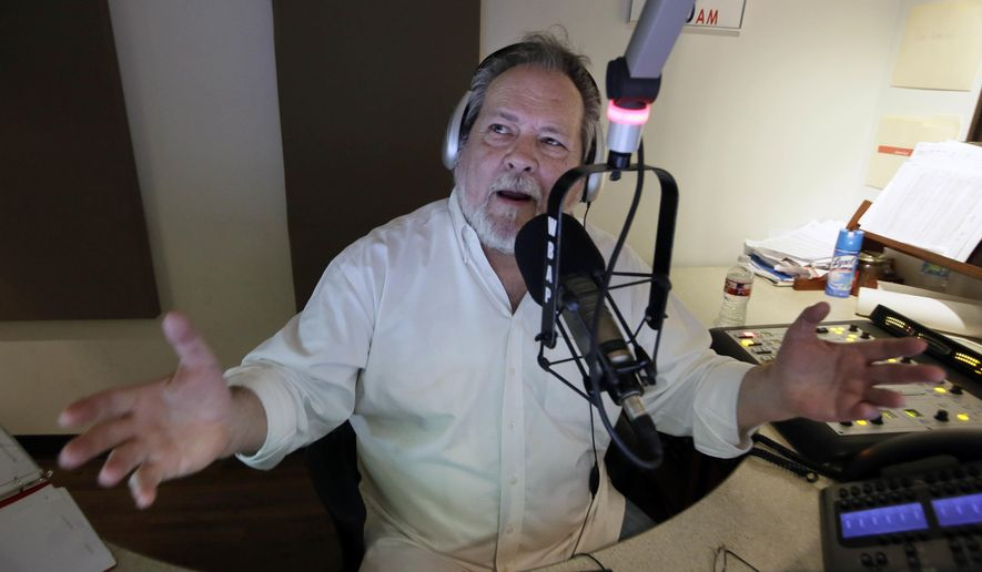 """ADVANCE FOR USE THURSDAY, OCT. 20, 2016 AND THEREAFTER-Radio talk show host Rick Roberts speaks will a caller during his program in Dallas on Tuesday, Sept. 6, 2016. """"I want America to be America,"""" he says. """"I want some semblance of what this country used to be. It's worth protecting. It's worth defending. I don't recognize this country anymore."""" (AP Photo/LM Otero)"""