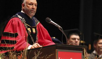FILE - In this Sept. 14, 2012, file photo, Iowa State President Steven Leath speaks as he is officially installed as the university's 15th president during a ceremony in Ames, Iowa. The university is shielding the names of several people who have traveled with Leath, including his best friend, a National Rifle Association Board member and a controversial athletics booster. (Bryon Houlgrave/The Des Moines Register via AP, File)