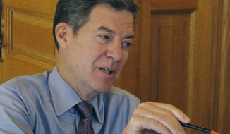 Kansas Gov. Sam Brownback answers a question from a reporter during a news conference, Monday, Oct. 17, 2016, at the Statehouse in Topeka, Kan. The Republican governor is not ruling out a tax increase to help balance the state's budget, though he thinks it would be harmful with the state facing what he calls a rural recession (AP Photo/John Hanna)